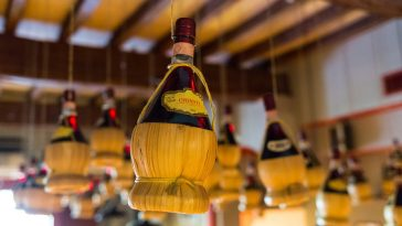 View of Chianti bottles hanging from the ceiling